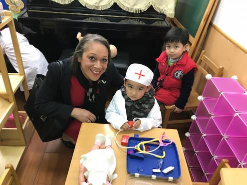 Head Teacher and Chinese Kindergarten Pupils