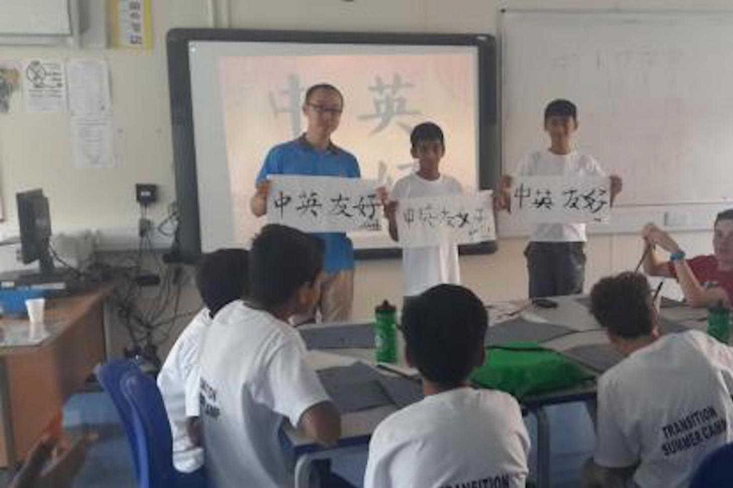 Students learning Chinese calligraphy