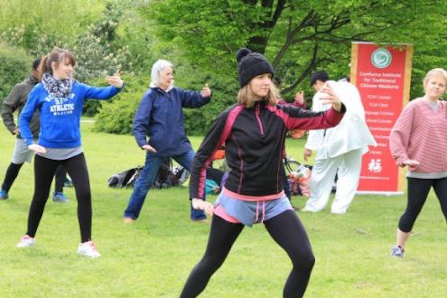 Participants practising taiji attentively