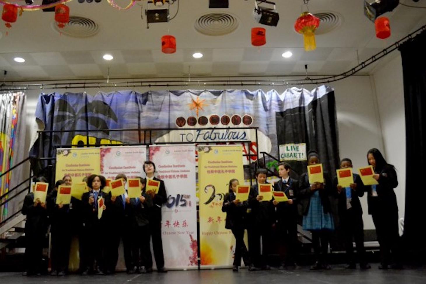 Students singing China's national anthem